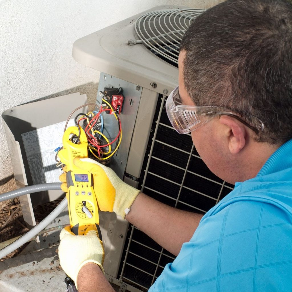 Man Fixing Air Conditioning