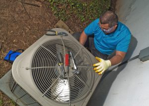 Man Repairing air conditioner HVAC
