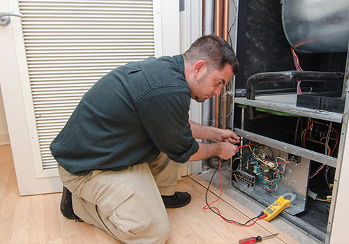Man Fixing HVAC System