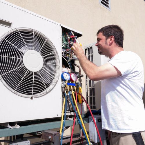 Man Repairing HVAC installation